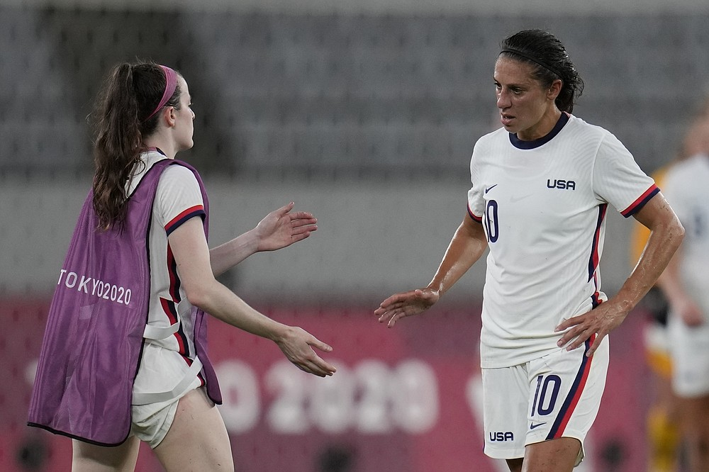 United States' Carli Lloyd, right, leaves the field after losing 0-3 against Sweden during a women's soccer match against Sweden at the 2020 Summer Olympics, Wednesday, July 21, 2021, in Tokyo. (AP Photo/Ricardo Mazalan)