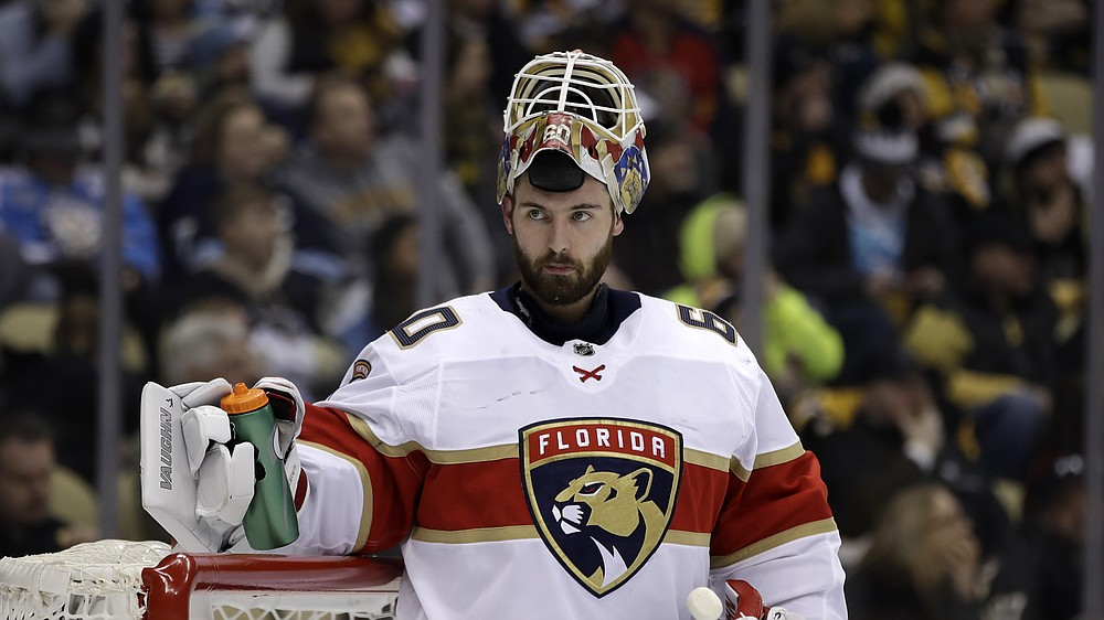 FILE - Florida Panthers goaltender Chris Driedger takes a timeout during the second period of an NHL hockey game against the Pittsburgh Penguins in Pittsburgh, in this Sunday, Jan. 5, 2020, file photo. Adam Larsson and Chris Driedger are going to the Seattle Kraken in the expansion draft. One person with knowledge of Larsson's deal said the defenseman has agreed to terms with Seattle on a $16 million, four-year contract. Another person with knowledge of Driedger's deal said the goaltender has agreed to a $10.5 million, three-year contract. The people spoke to The Associated Press on condition of anonymity Wednesday morning because the team was not announcing any moves until the expansion draft Wednesday night, July 21, 2021. (AP Photo/Gene J. Puskar, File)