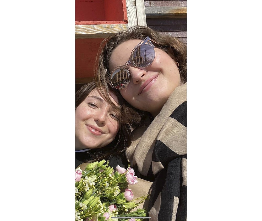 In this undated photo provided by Sergiy Gromov, Anastasia Gromova, right, is shown with her best friend Michelle Pazos. Pazos body was found. Nearly a month later, Anastasia is among the last of those missing in the Champlain Towers South collapse, the 24-year-old had just been accepted to a program teaching English to students in Japan. The young go-getter was visiting friends at the Surfside condo for one last hurrah. (Sergiy Gromov via AP)