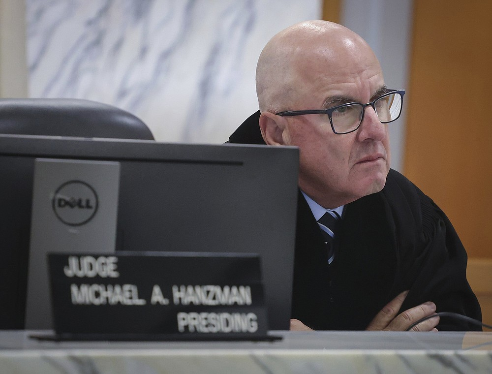 Miami-Dade Circuit Judge Michael Hanzman listens as tenants share their thoughts regarding the future of the site of the Champlain Towers South building that collapsed in Surfside, Fla., during a hearing, Wednesday, July 21, 2021, in Miami. Hanzman said victims and families who suffered losses in the collapse of the 12-story oceanfront Florida condominium will get a minimum of $150 million in compensation initially. (Carl Juste/Miami Herald via AP, Pool)