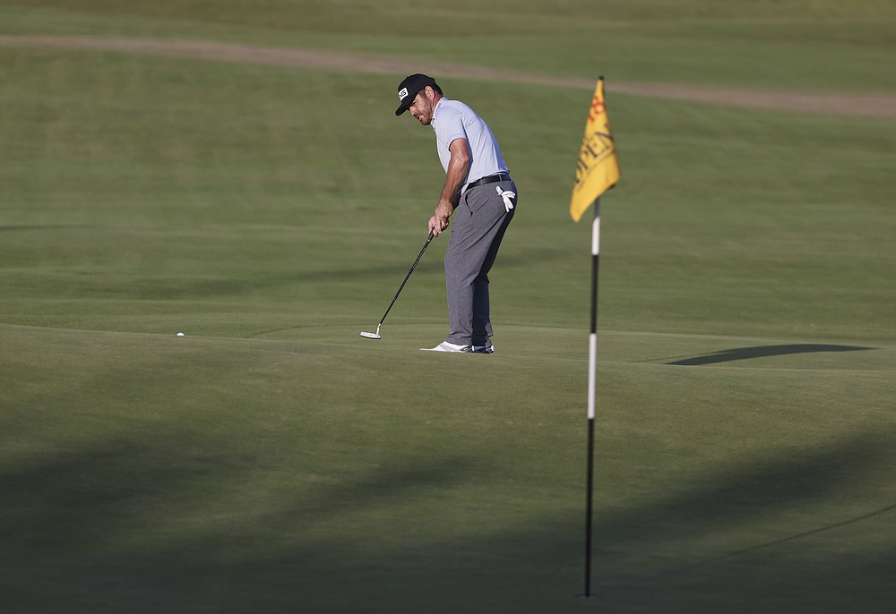 South Africa's Louis Oosthuizen puts on the 18th green during the third round of the British Open Golf Championship at Royal St George's golf course Sandwich, England, Saturday, July 17, 2021. (AP Photo/Ian Walton)