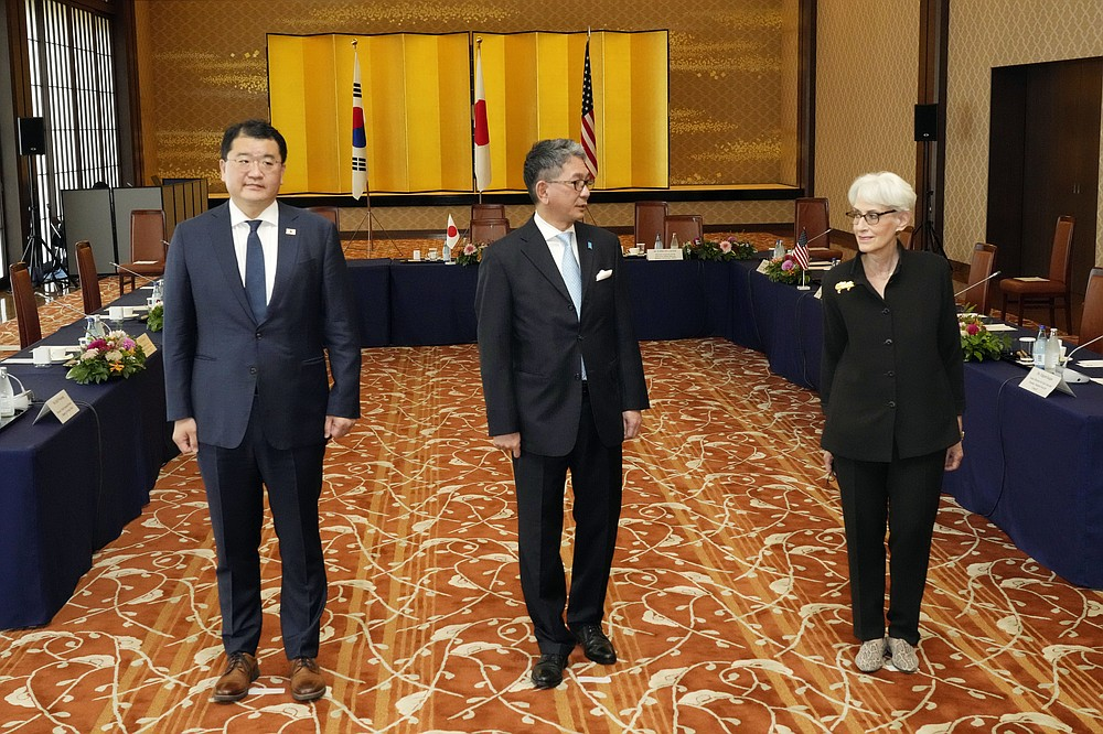 U.S. Deputy Secretary of State Wendy Sherman, right, South Korean First Vice Foreign Minister Choi Jong Kun, left, with Japanese Vice-Minister for Foreign Affairs Takeo Mori, center, pose for photographers prior to their trilateral meeting at the Iikura Guesthouse Wednesday, July 21, 2021, in Tokyo. (AP Photo/Eugene Hoshiko)