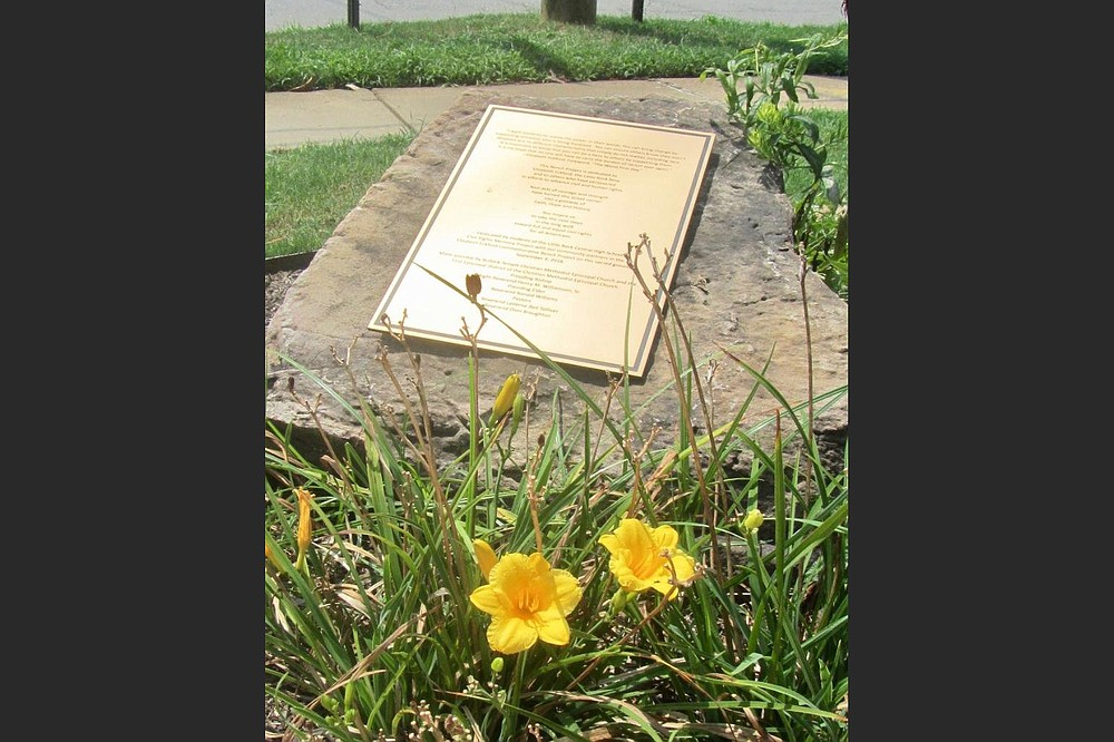 A plaque marks the bus stop where a white mob harried Elizabeth Eckford in 1957. (Special to the Democrat-Gazette/Marcia Schnedler)
