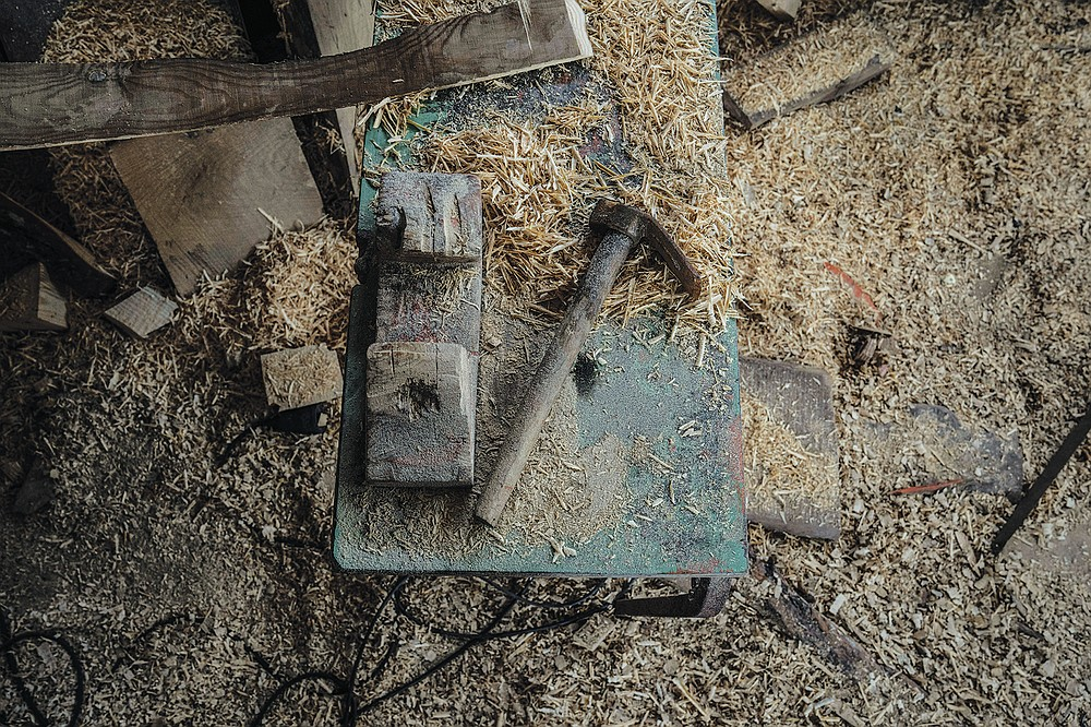 """Tools are seen among wood shavings inside a boatyard in Karlovasi town, Samos Island , Greece, Thursday, June 10, 2021. Yes it's an art too, but it's also heavy work, it's tough work,"""" Giorgos Kiassos, one of the last remaining boatbuilders on Samos island said. The art of designing and building these vessels, done entirely by hand, is under threat. Fewer people order wooden boats since plastic and fiberglass ones are cheaper to maintain .(AP Photo/Petros Giannakouris)"""