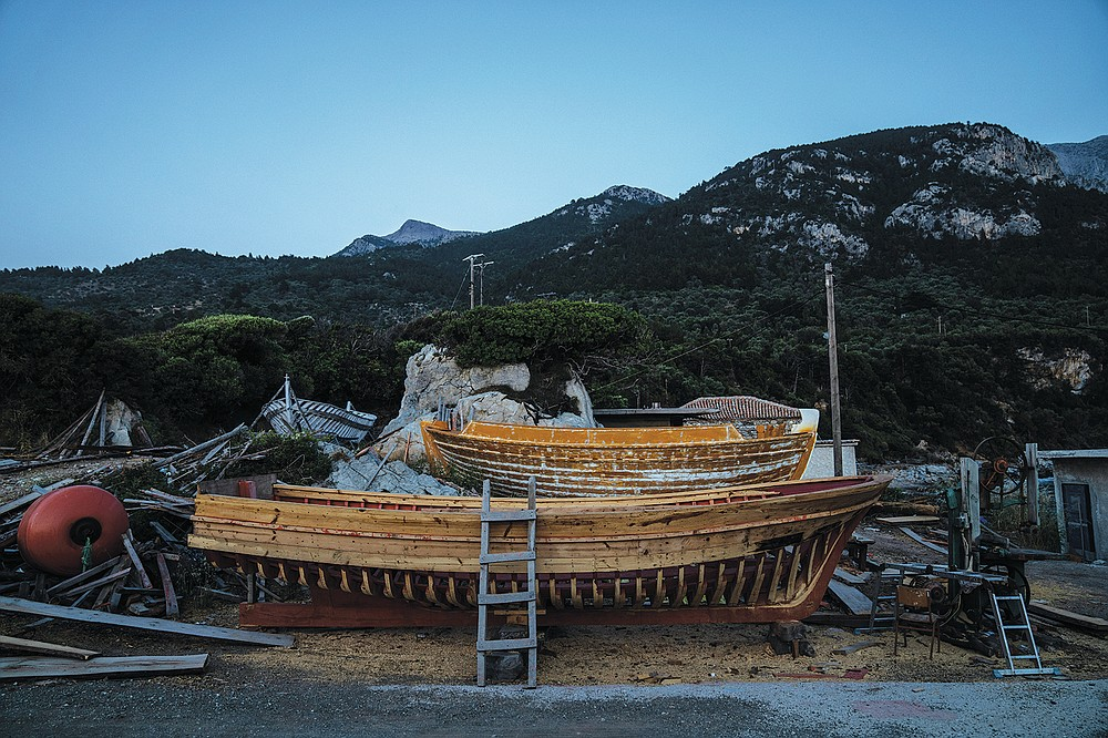 Wooden boats stands at Agios Isidoros boatyard on the eastern Aegean island of Samos, Greece, on Wednesday, June 9, 2021. The art of designing and building these vessels, done entirely by hand, is under threat. Fewer people order wooden boats since plastic and fiberglass ones are cheaper to maintain. (AP Photo/Petros Giannakouris)