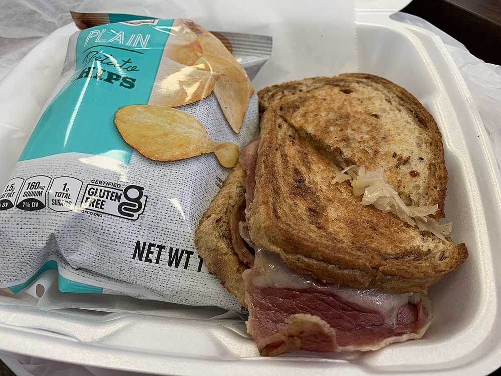 Our Reuben from the deli at Heights Corner Market was prepared to order at lunch time, with sliced corned beef, fresh sauerkraut and Swiss on a marbled rye. (Arkansas Democrat-Gazette/Eric E. Harrison)