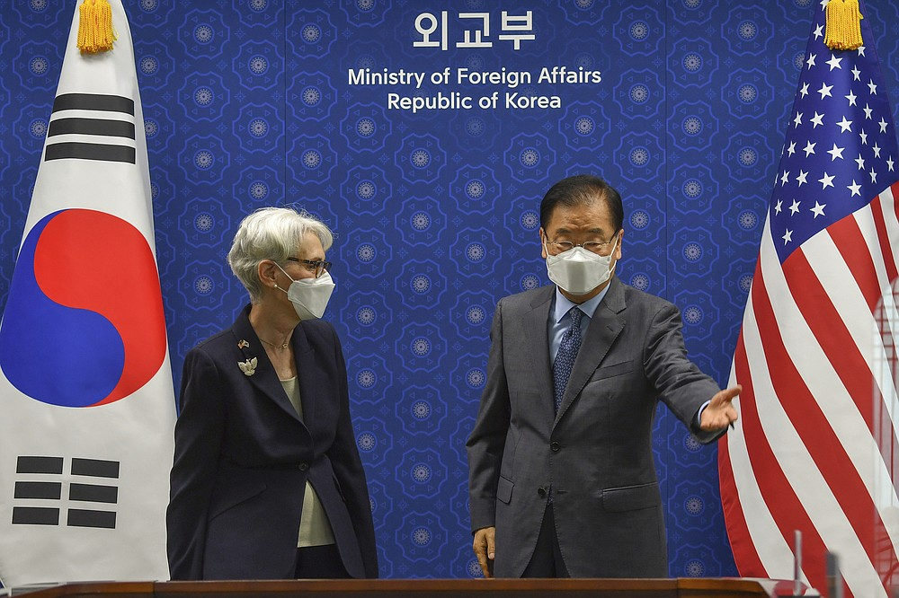 South Korean Foreign Minister Chung Eui-yong gestures to U.S. Deputy Secretary of State Wendy Sherman prior to their meeting at Foreign Ministry in Seoul, South Korea, Thursday, July 22, 2021. The United States, Japan and South Korea on Wednesday reaffirmed their commitment to work together on North Korea's denuclearization and other regional threats but made no progress in bringing closer together the two U.S. allies. (Song Kyung-seok/Pool Photo via AP)