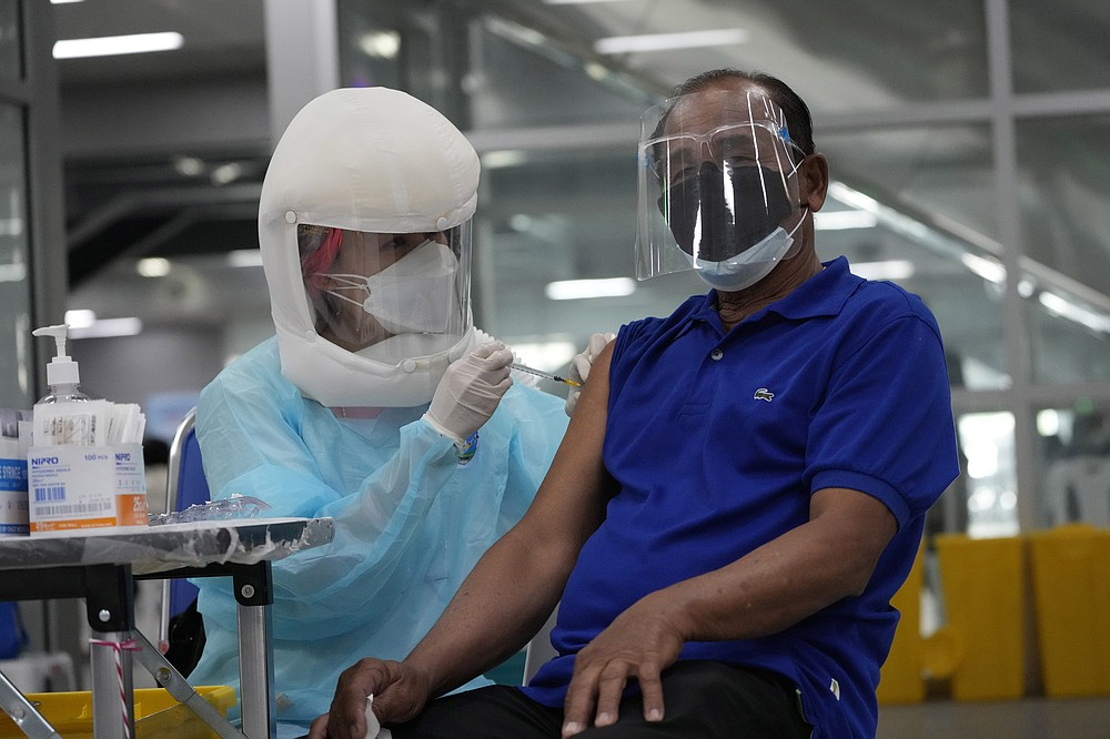 A health worker administers shots of the AstraZeneca COVID-19 vaccine at the Central Vaccination Center in Bangkok, Thailand, Thursday, July 22, 2021. (AP Photo/Sakchai Lalit)