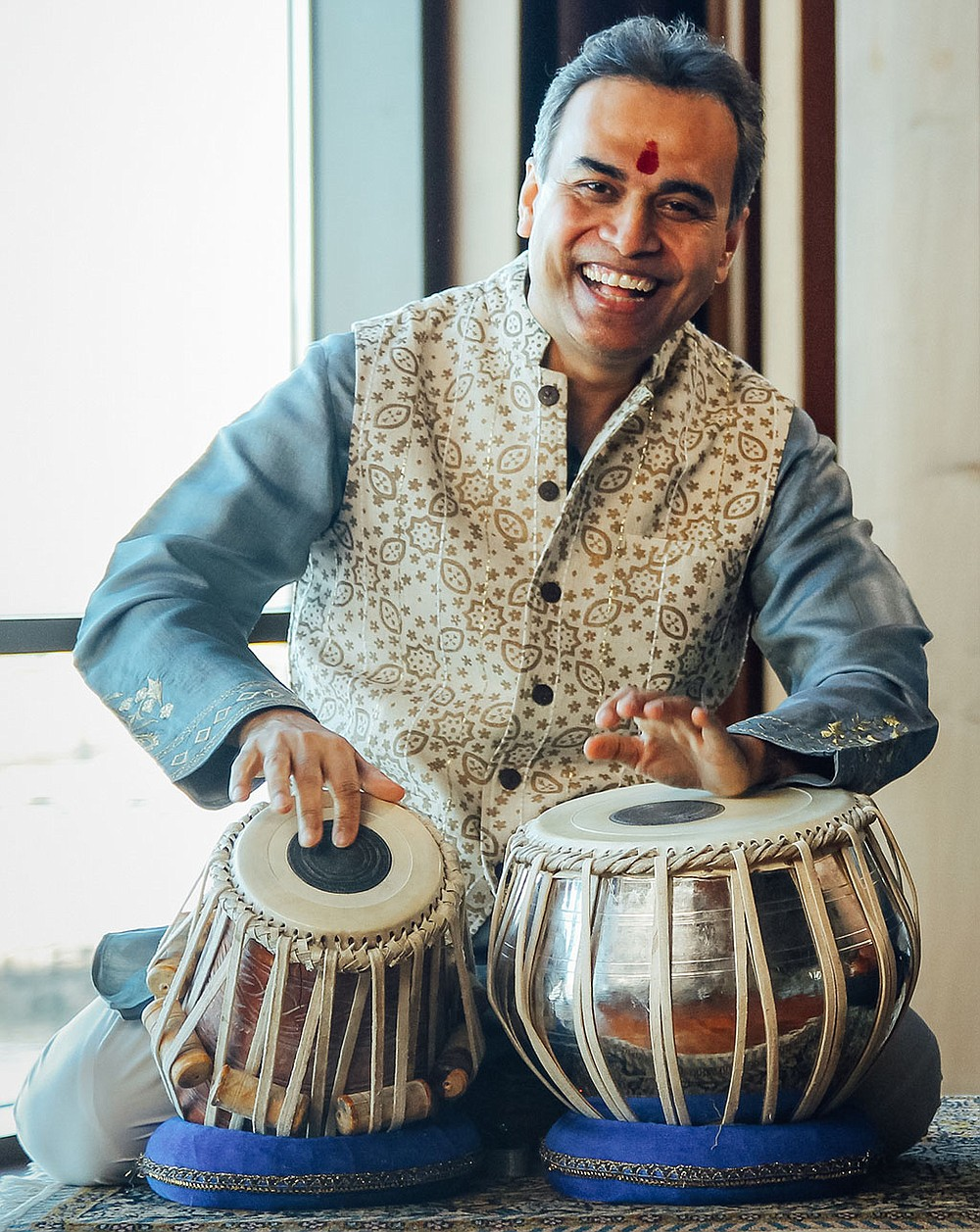 """SoNA's 2021-22 season will highlight principal clarinetist Trevor Stewart, featured in November on Mozart's Clarinet Concerto; Canadian pianist and composer Heather Schmidt, in Fayetteville for her Arkansas premiere of """"Phoenix Ascending"""" in January; and international tabla maestro Sandeep Das in February for a performance of Dinuk Wijeratne's Tabla Concerto.  (Courtesy Photos)"""