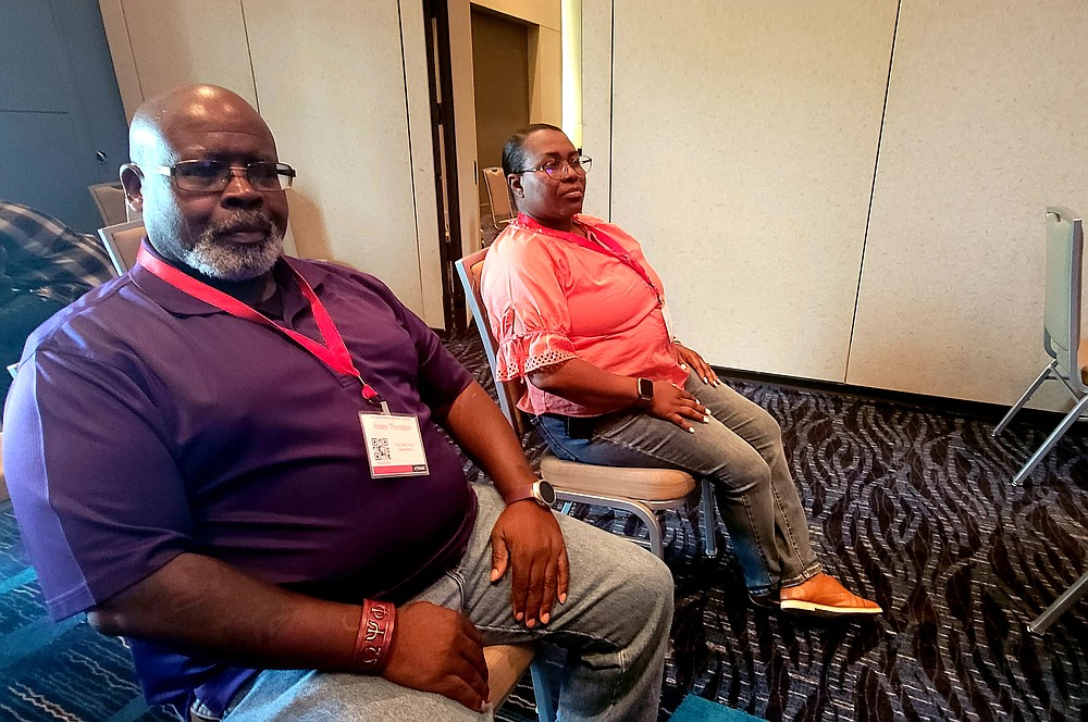 Pine Bluff Police Department Lt. Hosea Thompson (left) and PBPD Public Relations Officer Helen Irby attend a course focused on community engagement and interaction. (Pine Bluff Commercial/Eplunus Colvin)