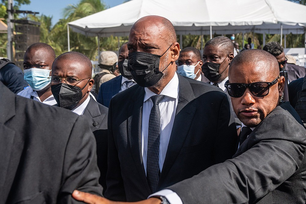 New Haitian Prime Minister Ariel Henry arrives Friday for Jovenel Moise's funeral. Henry was installed as prime minister with the backing of key international diplomats. (The New York Times/Federico Rios)
