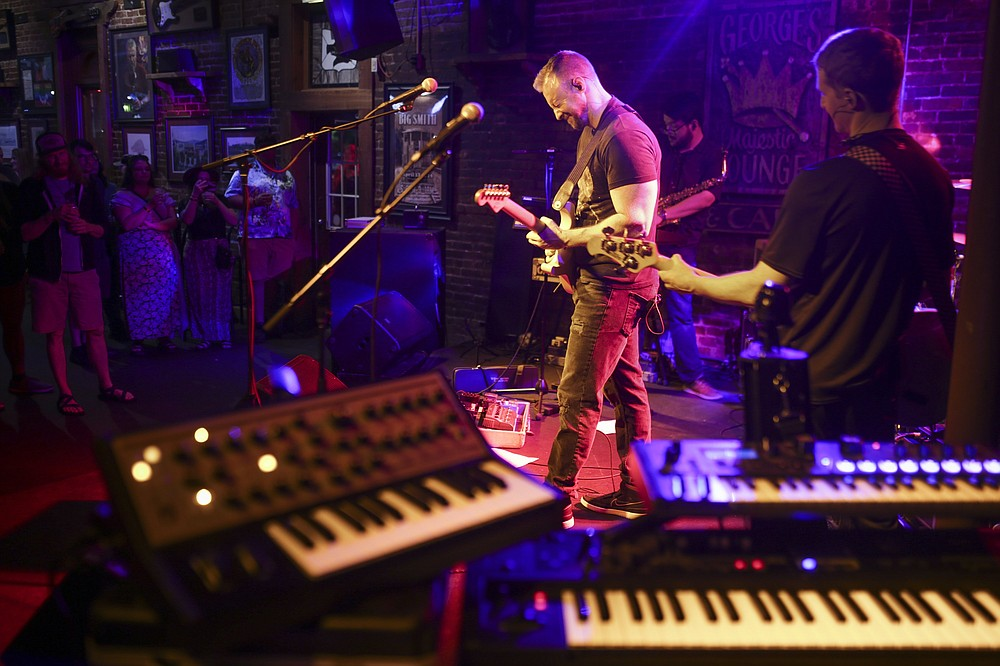 Jim Goza (center) performs with his band The Juice, Saturday, July 17, 2021 at George's Majestic Lounge in Fayetteville. Check out nwaonline.com/210718Daily/ for today's photo gallery.  (NWA Democrat-Gazette/Charlie Kaijo)