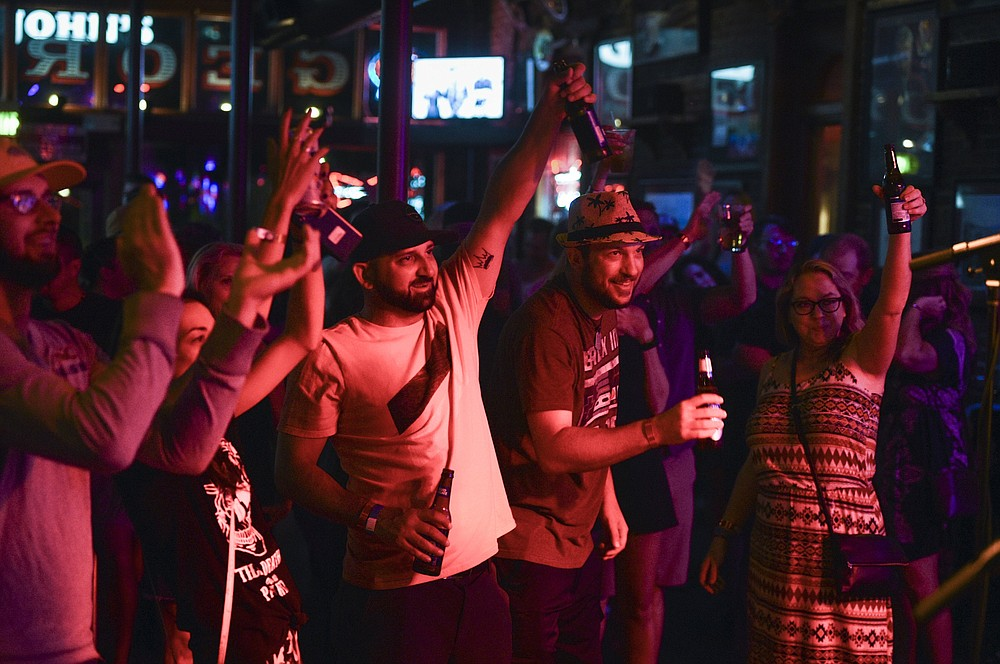Attendees cheer, Saturday, July 17, 2021 at George's Majestic Lounge in Fayetteville. Check out nwaonline.com/210718Daily/ for today's photo gallery.  (NWA Democrat-Gazette/Charlie Kaijo)