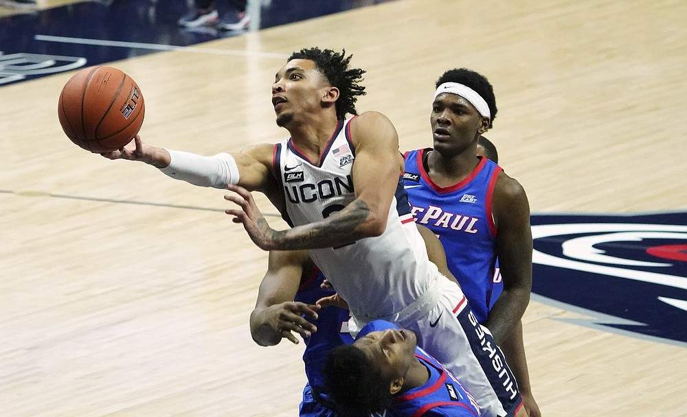 FILE - In this Dec. 30, 2020, file photo, Connecticut guard James Bouknight (2) shoots against DePaul during the first half of an NCAA college basketball game in Storrs, Conn. (David Butler II/Pool Photo via AP, File)