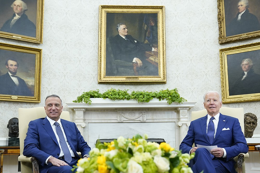 President Joe Biden, right, meets with Iraqi Prime Minister Mustafa al-Kadhimi, left, in the Oval Office of the White House in Washington, Monday, July 26, 2021. (AP Photo/Susan Walsh)