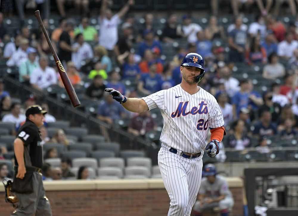 New York Mets' Pete Alonso flips his bat after flying out to centerfield during the first inning of the first game of a baseball doubleheader against the Atlanta Braves, Monday, July 26, 2021, in New York. (AP Photo/Bill Kostroun)
