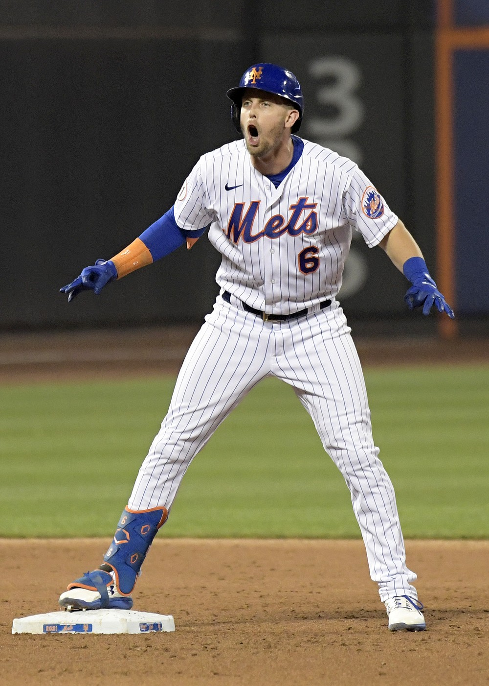 New York Mets' Jeff McNeil reacts after hitting an RBI-double, scoring Brandon Nimmo, in the fifth inning of the second game of a baseball doubleheader against the Atlanta Braves, Monday, July 26, 2021, in New York. (AP Photo/Bill Kostroun)