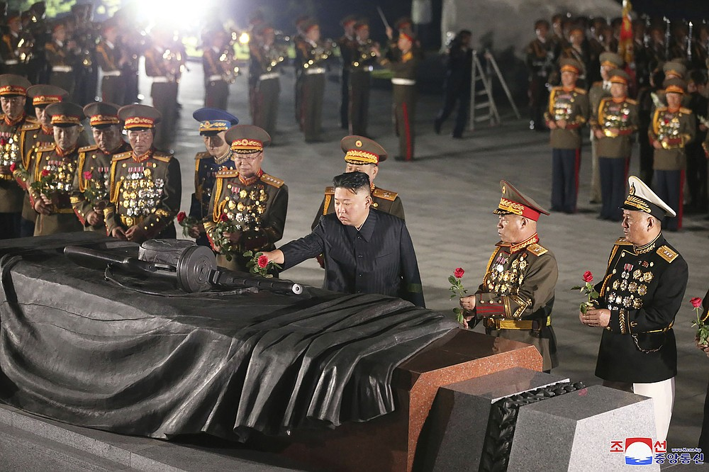 """In this photo provided by the North Korean government, North Korean leader Kim Jong Un, front center, offers a flower at a liberation war martyrs cemetery in Pyongyang, North Korea, Tuesday, July 27, 2021 to mark the end of the Korean War. Independent journalists were not given access to cover the event depicted in this image distributed by the North Korean government. The content of this image is as provided and cannot be independently verified. Korean language watermark on image as provided by source reads: """"KCNA"""" which is the abbreviation for Korean Central News Agency. (Korean Central News Agency/Korea News Service via AP)"""