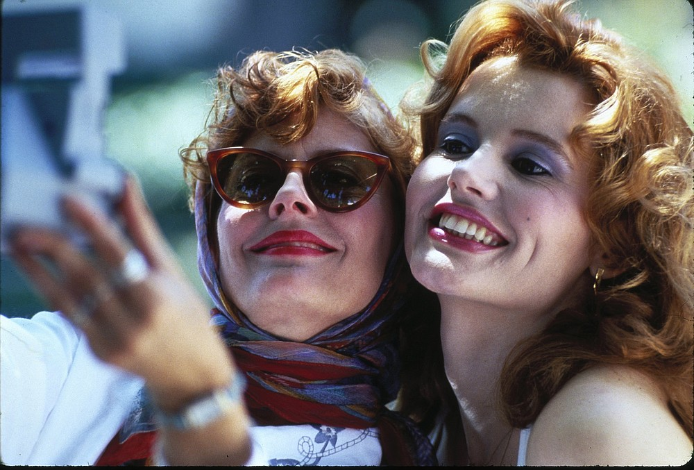 """On the Cover: """"Thelma & Louise,"""" starring BFF founder Geena Davis (right) and Susan Sarandon, celebrates its 30th anniversary at this year's festival with a drive-in screening at 8 p.m. Aug. 3 at the 112 Drive-In in Fayetteville. A live-streamed conversation with Davis and screenwriter Callie Khouri will follow. Tickets are $30 per car at bentonvillefilm.org/tickets-passes. (File Photo)"""