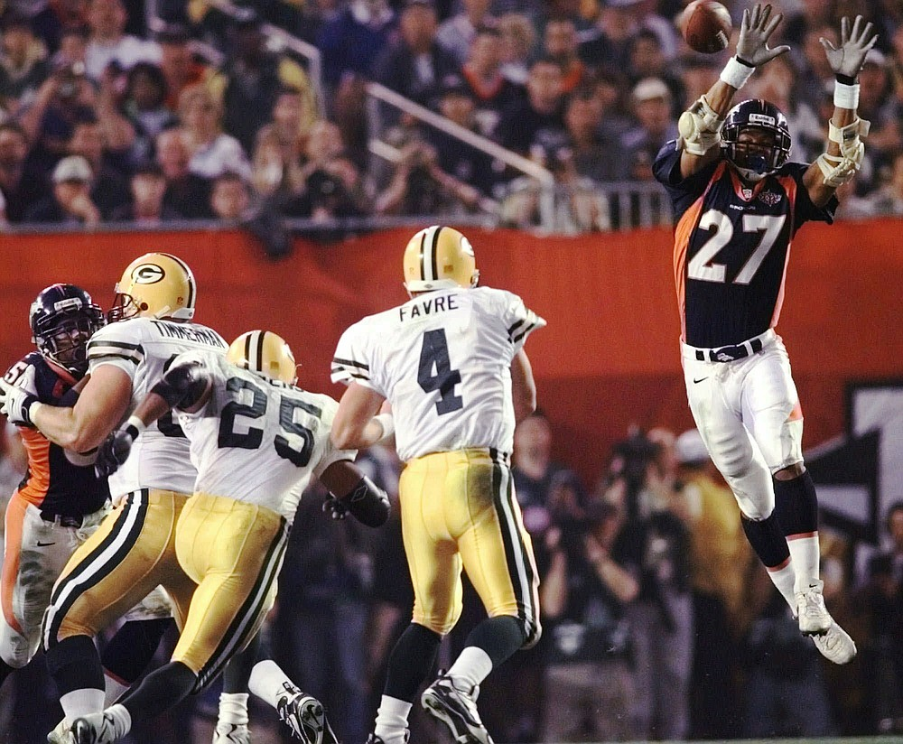 FILE - In this Jan. 25, 1998, file photo, Denver Broncos safety Steve Atwater (27) jumps into the air in an attempt to block a pass by Green Bay Packers quarterback Brett Favre during the third quarter of NFL football's Super Bowl 32 at San Diego's Qualcomm Stadium. At left are Packers' Dorsey Levens (25) and Adam Timmerman (63). Atwater is part of the 2020 class to be inducted into the Pro Football Hall of Fame. (AP Photo/John Gaps III, File)