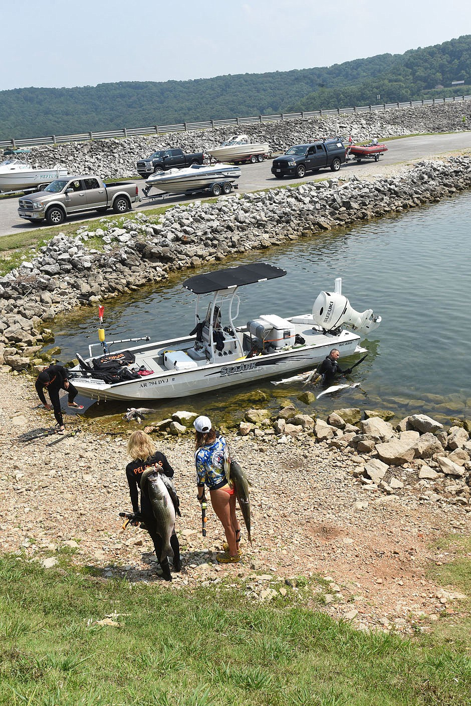 Contestants arrive July 22 2021 at the Beaver Dam day-use area to check in their fish. (NWA Democrat-Gazette/Flip Putthoff)