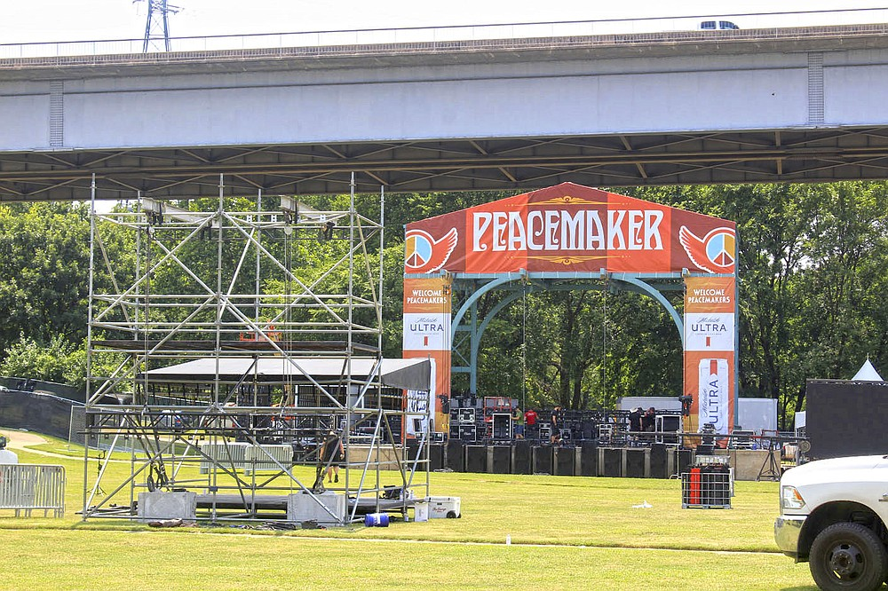 Workers prepare the Peacemaker Festival stage on Thursday, July 29, 2021 in preparation for the event tonight and Saturday at Harry E. Kelley Park in Fort Smith.