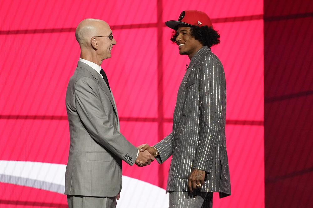 NBA Commissioner Adam Silver greets Jalen Green after he was selected by the Houston Rockets as the second pick during the first round of the NBA basketball draft, Thursday, July 29, 2021, in New York. (AP Photo/Corey Sipkin)
