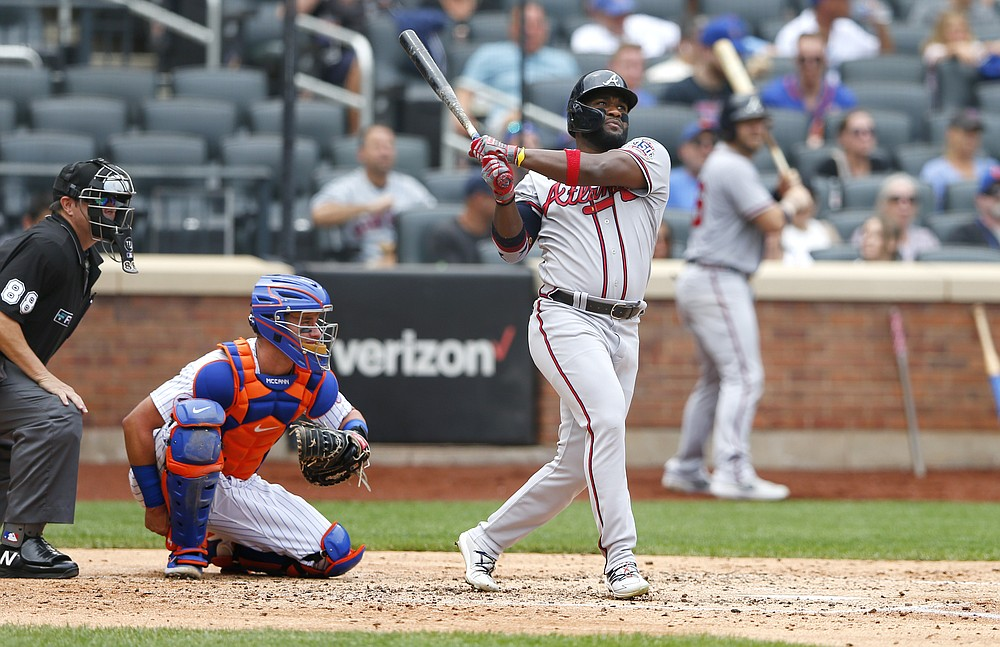 Atlanta Braves right fielder Abraham Almonte (34) follows through on a home run against the New York Mets during the fourth inning of a baseball game Thursday, July 29, 2021, in New York. (AP Photo/Noah K. Murray)