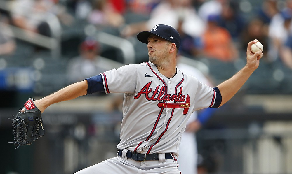 Atlanta Braves starting pitcher Drew Smyly (18) throws against the New York Mets during the second inning of a baseball game. Saturday, July 29, 2021, in New York. (AP Photo/Noah K. Murray)
