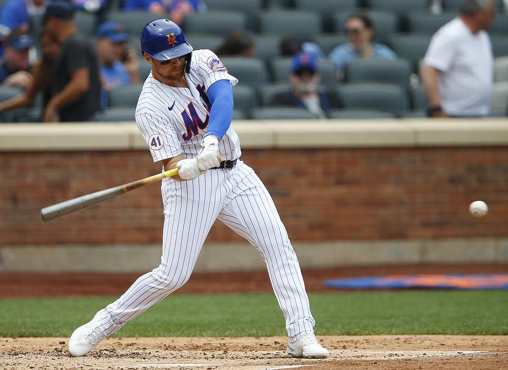 New York Mets third baseman Brandon Drury (35) hits a single against the Atlanta Braves during the second inning of a baseball game Thursday, July 29, 2021, in New York. (AP Photo/Noah K. Murray)