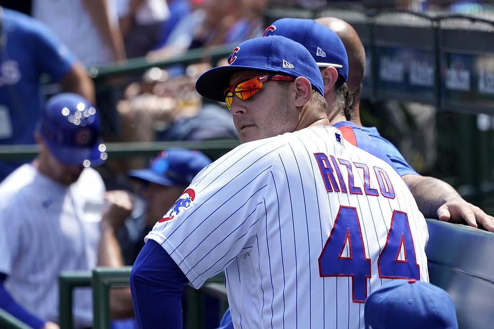 Chicago Cubs' Anthony Rizzo sits on the bench during a baseball game against the Cincinnati Reds Thursday, July 29, 2021, in Chicago. (AP Photo/Charles Rex Arbogast)