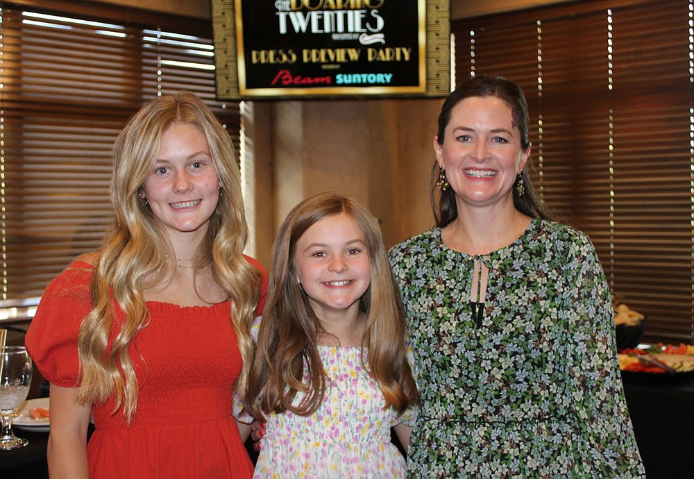 Kate Carter (from left); Rose Carter, Mission Moment speaker ; and Summer Carter attend the Kiss a Pig preview party. (NWA Democrat-Gazette/Carin Schoppmeyer)