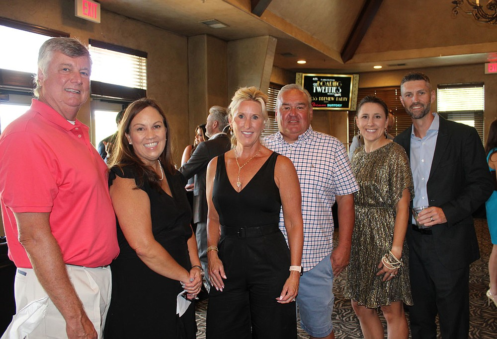 Scott and Tammy Stephens (from left), Carol and Tracey Johnson and Melissa and David Steeves help support the American Diabetes Association. (NWA Democrat-Gazette/Carin Schoppmeyer)