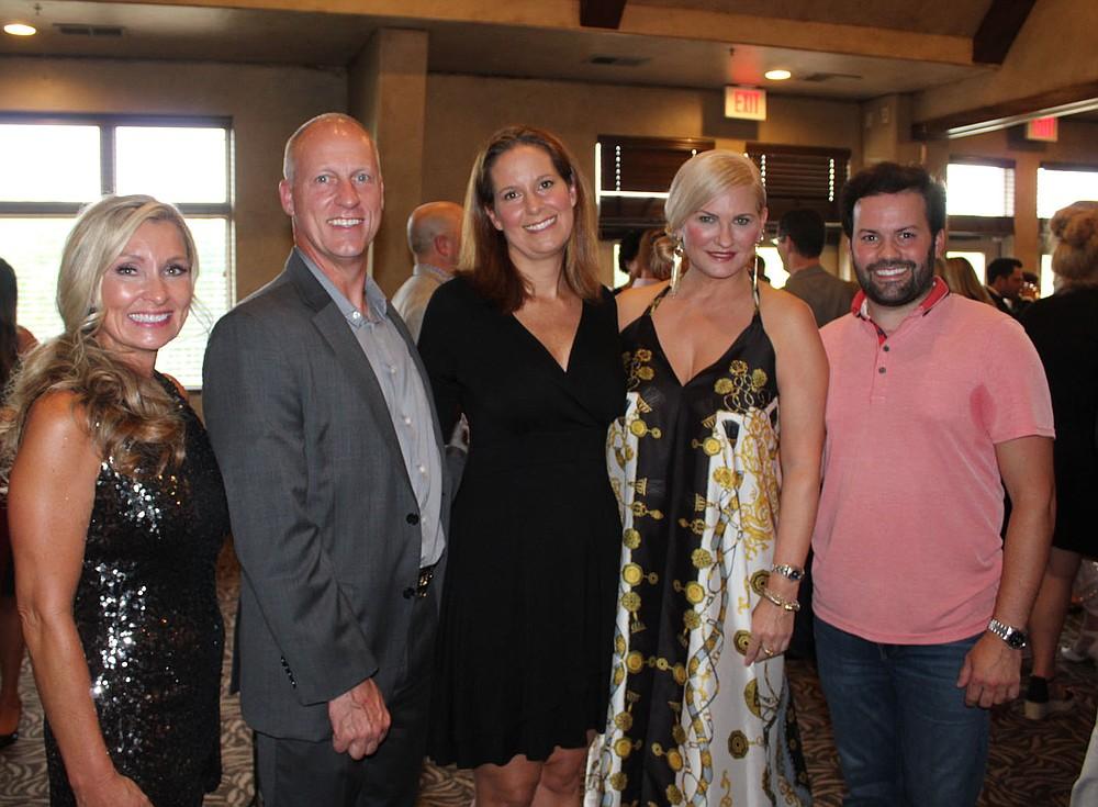 Chanci Chaney (from left), Mike Lemna, Kiss Pig candidate Jennifer Kierce, Holli Hutchinson and Blake McGilton attend the preview party. (NWA Democrat-Gazette/Carin Schoppmeyer)