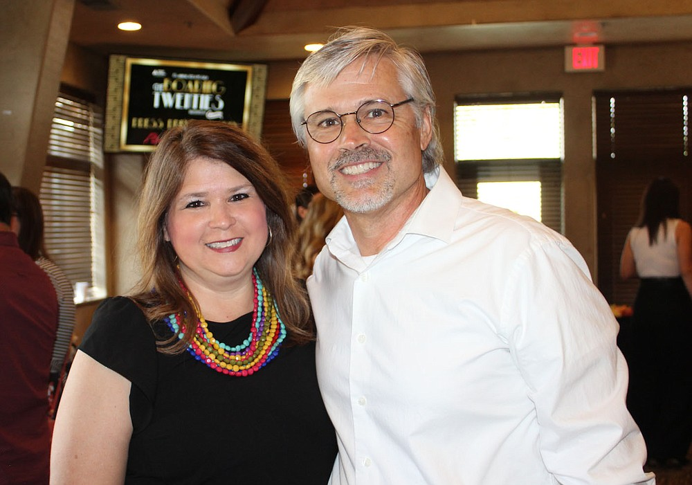 Candidate Jan and Eric Holland attend the preview party. (NWA Democrat-Gazette/Carin Schoppmeyer)