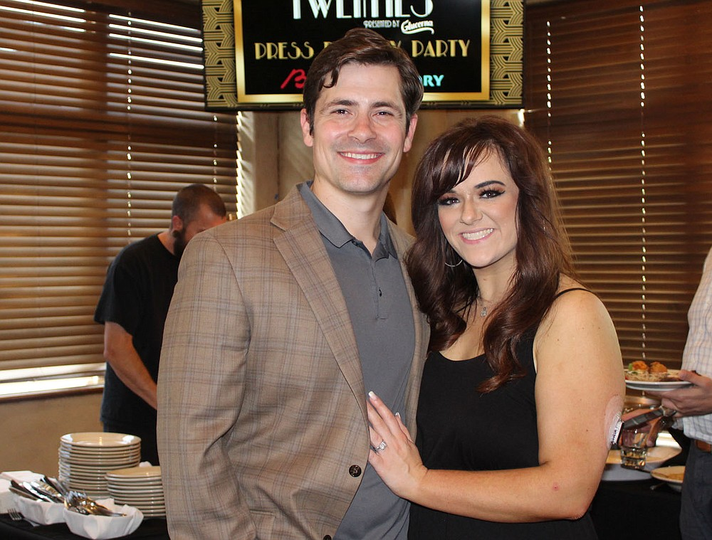 E.J. and Lauren Roussell enjoy the preview party. (NWA Democrat-Gazette/Carin Schoppmeyer)