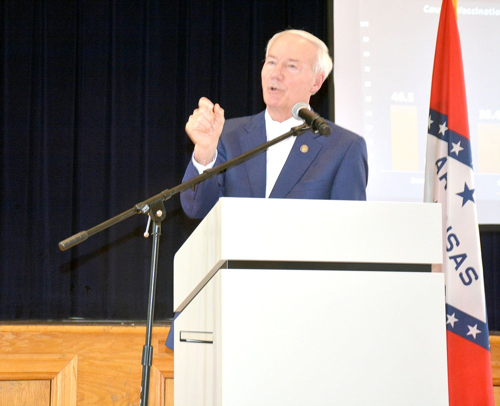 Marc Hayot/Siloam Sunday Governor Asa Hutchinson addresses a local resident's concerns related to the coronavirus vaccine during his Covid Conversation held at 11 a.m. on Friday at the Siloam Springs Community Building. Several members of the audience voiced their objections to the vaccine and the possibility of a new mask mandate during the governor's talk.