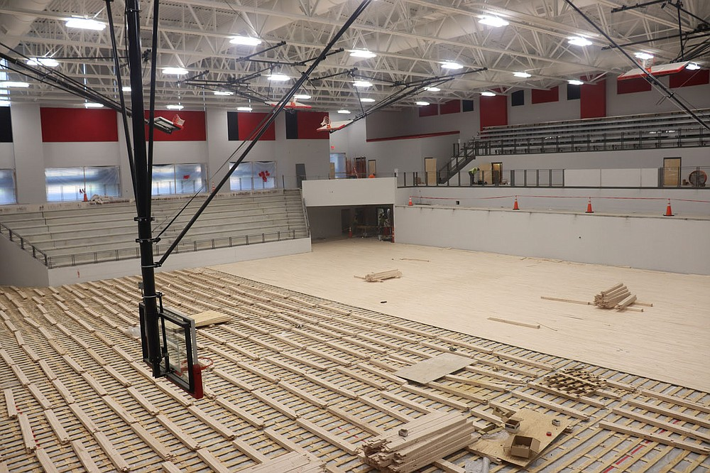 The new sports arena at Fort Smith Northside is nearing completion as workers are installing the new wood flooring. The new arena will seat 2,300, allowing the school to host Class 6A state tournaments. The arena is expected to be completed for this fall. (Submitted photo by Glenn Gilley, Fort Smith Public Schools)