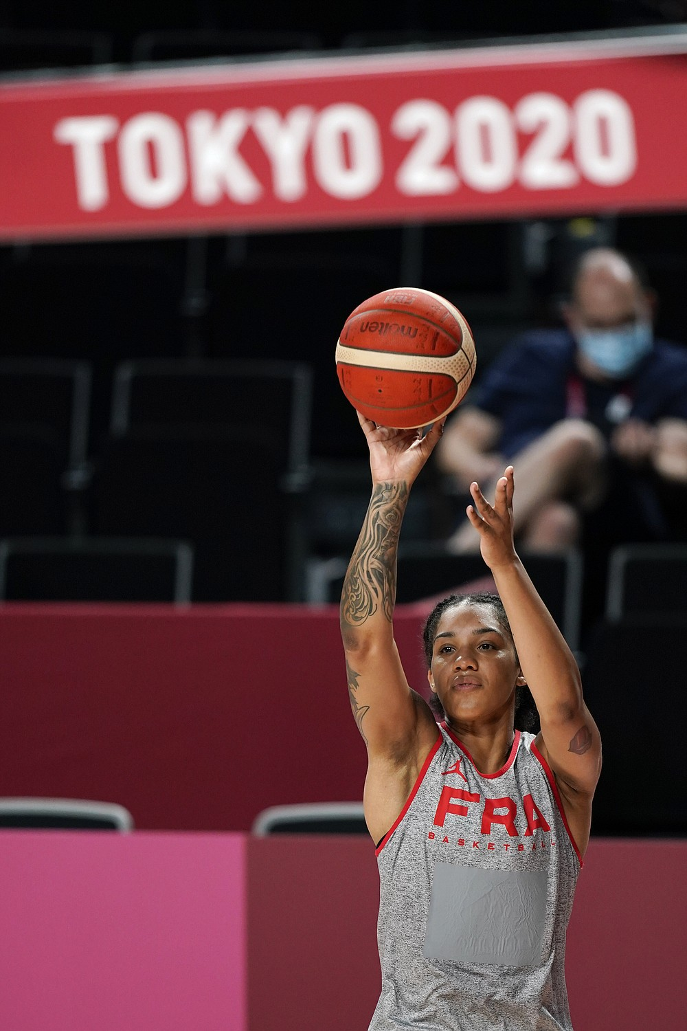France's Gabby Williams shoots during a women's basketball practice at the 2020 Summer Olympics, Saturday, July 24, 2021, in Saitama, Japan. (AP Photo/Charlie Neibergall)