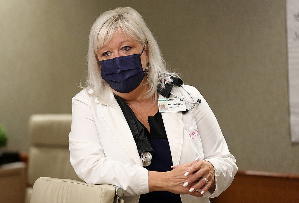 """""""I've cried every single day this week because the people are so young now,"""" Dr. Kathy Parnell, an internal medicine specialist at Baptist Health Medical Center in Little Rock, said recently of the strain of  treating the latest wave of covid-19 patients.  (Arkansas Democrat-Gazette/Thomas Metthe)"""