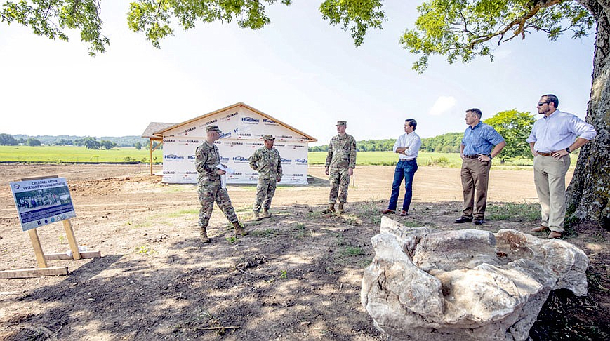 Photo Submitted Deputy Chief Bryan Warner and Chief of Staff Todd Enlow toured the site of 21 new Cherokee veteran houses being built through a joint effort with the U.S. Department of Defense Innovative Readiness Training program. Seven are being built in the first year of the project.