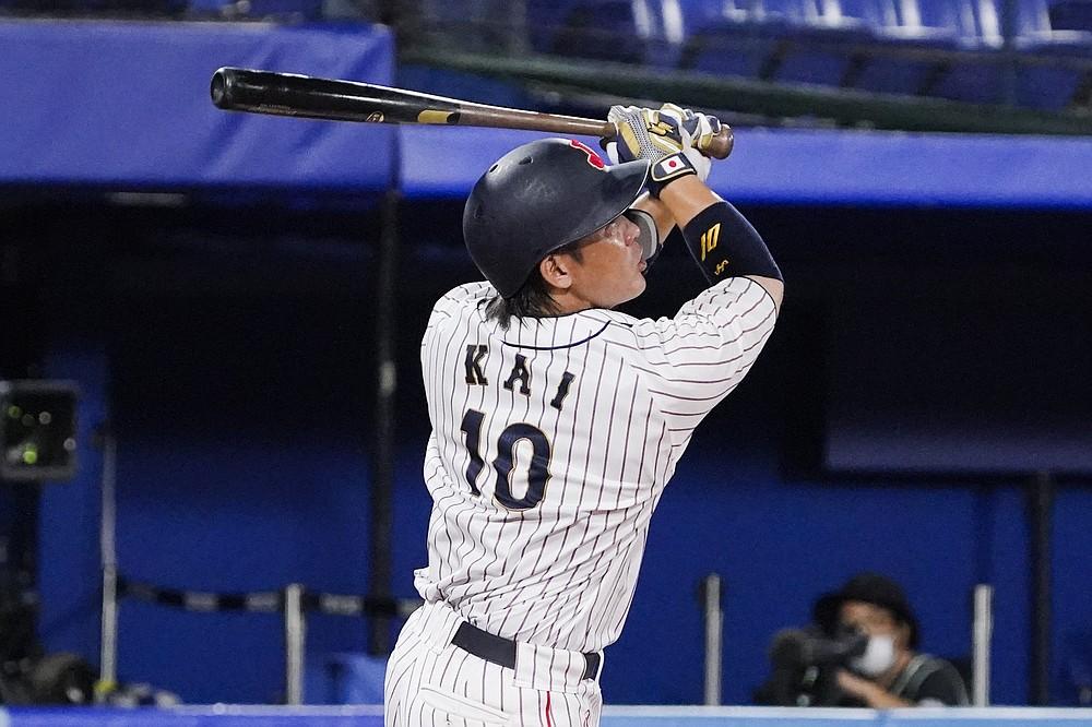 Japan's Takuya Kai follows through after hitting during the tenth inning of a baseball game against the United States at the 2020 Summer Olympics, Monday, Aug. 2, 2021, in Yokohama, Japan. Japan won 7-6. (AP Photo/Sue Ogrocki)