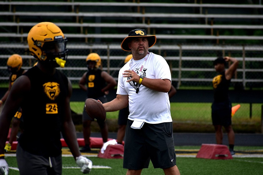 Watson Chapel Coach Jared Dutton throws a pass during practice Monday, Aug. 2, 2021. (Pine Bluff Commercial/I.C. Murrell)