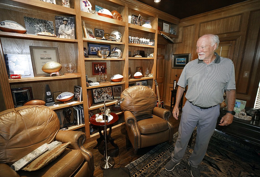Former Dallas Cowboys and NFL football great Cliff Harris stands in his study during an interview at his home in North Dallas, Wednesday, June 30, 2021. (AP Photo/LM Otero)