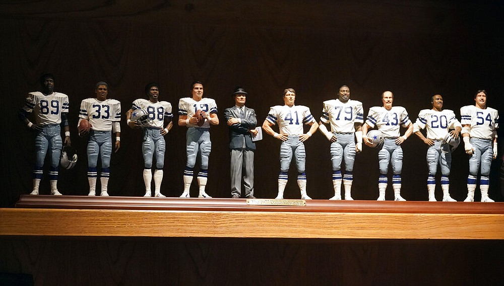 The miniature likeness of the 1977 Dallas Cowboys team is displayed on a shelf at the home of former Cowboys and NFL football great Cliff Harris (43) in North Dallas, Wednesday, June 30, 2021. (AP Photo/LM Otero)