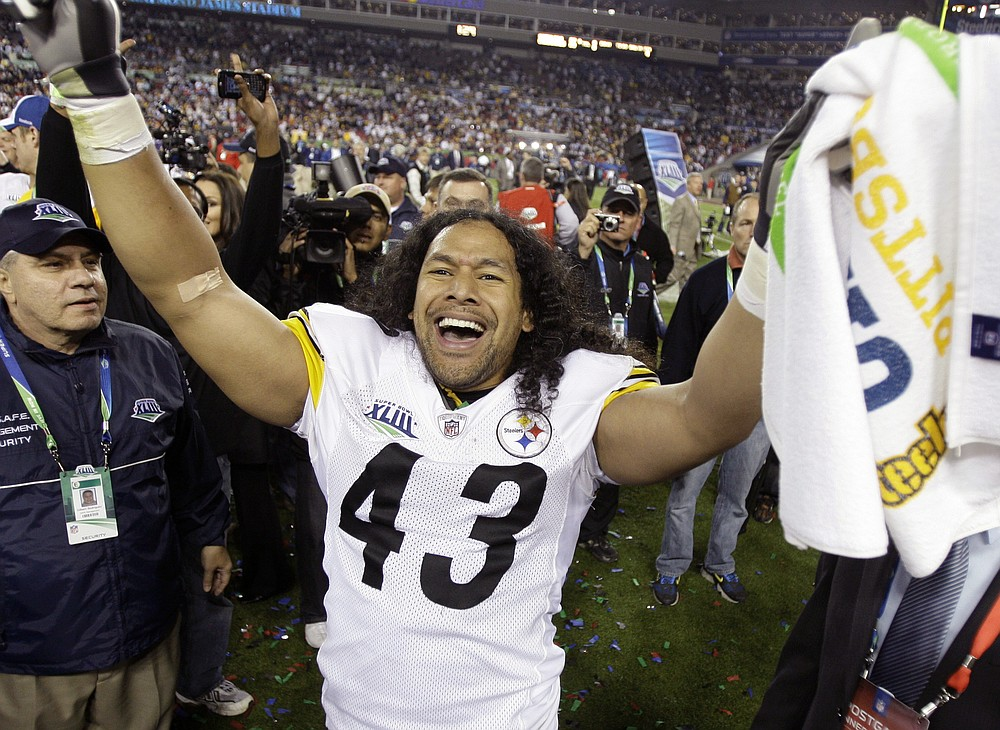 FILE - In this Sunday, Feb. 1, 2009 file photo, Pittsburgh Steelers safety Troy Polamalu celebrates following Pittsburgh's 27-23 win over the Arizona Cardinals in the NFL Super Bowl XLIII football game in Tampa, Fla.  Former Pittsburgh Steelers star Troy Polamalu has carved his own unique path to the Hall of Fame. (AP Photo/Amy Sancetta, File)