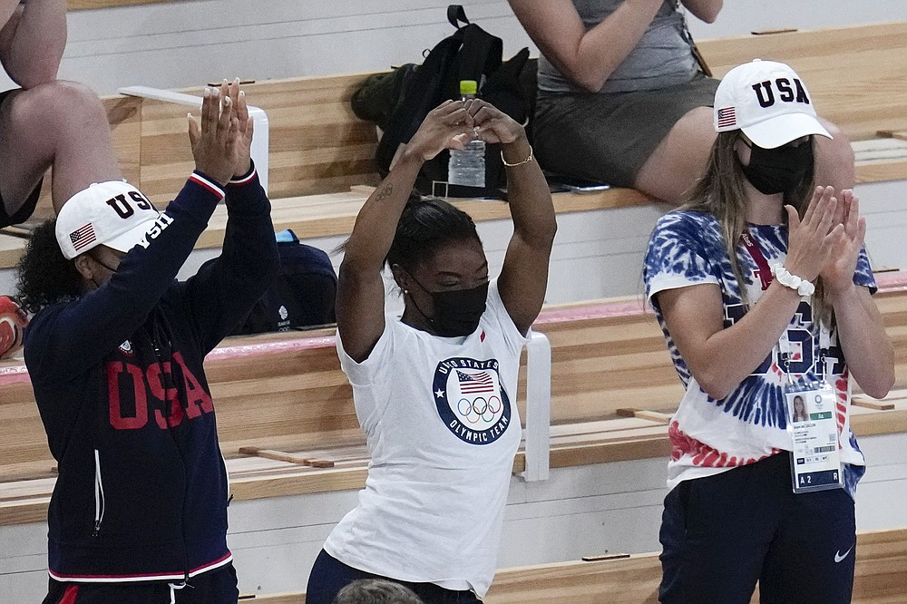 Simone Biles of the United States, center, celebrates after teammate Mykayla Skinner won the silver medal in the vault during the artistic gymnastics women's apparatus final at the 2020 Summer Olympics, Sunday, Aug. 1, 2021, in Tokyo, Japan. (AP Photo/Gregory Bull)