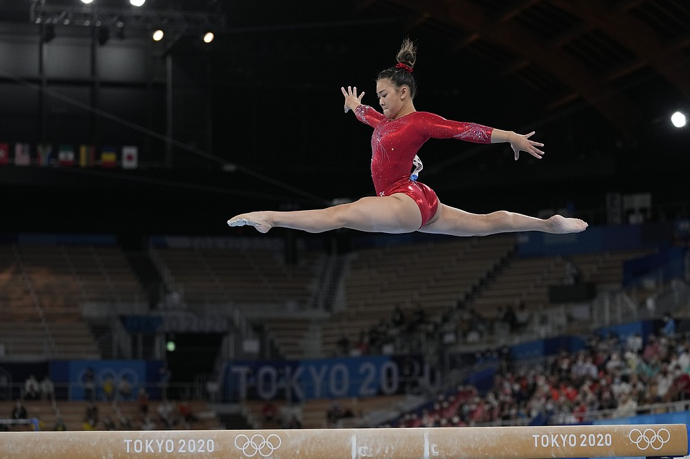 Sunisa Lee, of the United States, performs on the balance beam during the artistic gymnastics women's apparatus final at the 2020 Summer Olympics, Tuesday, Aug. 3, 2021, in Tokyo, Japan. (AP Photo/Ashley Landis)
