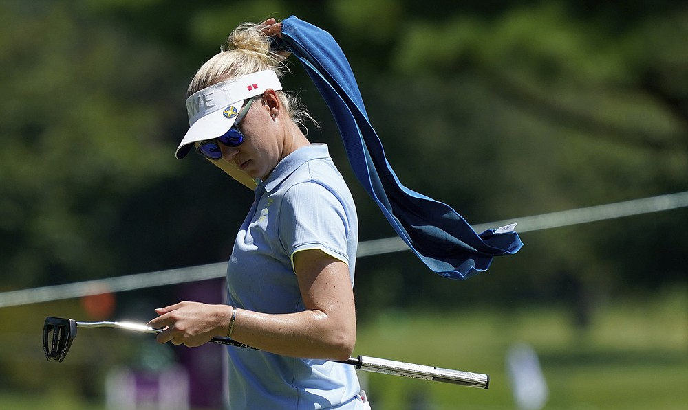 Madelene Sagstrom, of Sweden, walks on 13th green during the first round of the women's golf event at the 2020 Summer Olympics, Wednesday, Aug. 4, 2021, at the Kasumigaseki Country Club in Kawagoe, Japan. (AP Photo/Matt York)
