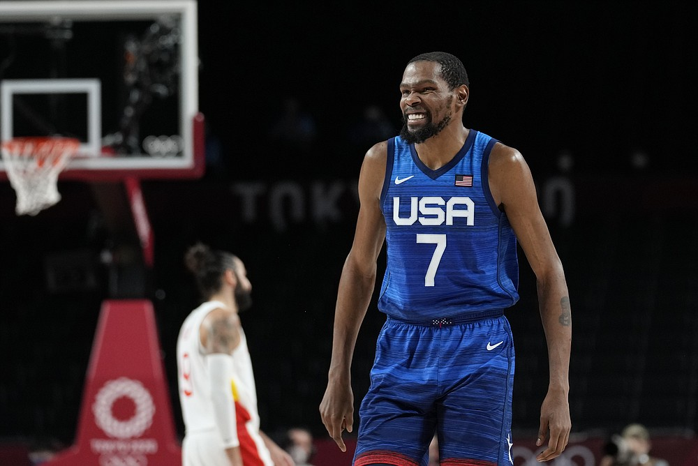 United States' Kevin Durant (7) reacts during men's basketball quarterfinal game against Spain at the 2020 Summer Olympics, Tuesday, Aug. 3, 2021, in Saitama, Japan. (AP Photo/Eric Gay)